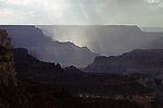 South Rim Grand Canyon storm clouds and sunray light on rock formations Arizona State