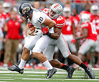 Ohio State Buckeyes linebacker Darron Lee (43) sacks Kent State Golden Flashes quarterback Colin Reardon (10) in the 2nd quarter of their game in Ohio Stadium on September 13, 2014.  (Dispatch photo by Kyle Robertson)