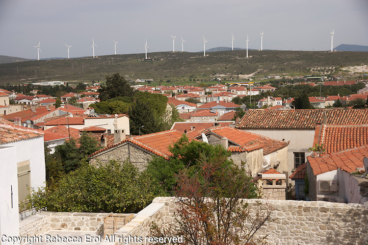 View from Aegean town of Alacati to wind turbines beyond, Turkey