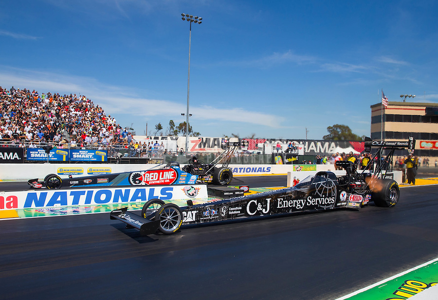 Aug 2, 2015; Sonoma, CA, USA; NHRA top fuel driver Dace Connolly (near) races alongside J.R. Todd during the Sonoma Nationals at Sonoma Raceway. Mandatory Credit: Mark J. Rebilas-