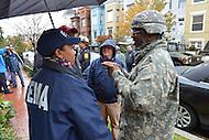 October 30, 2012  (Washington, DC)  Major General Errol Schwartz, Commanding General, D.C. National Guard, (right) speaks with FEMA officials touring Hurricane Sandy storm damage.  (Photo by Don Baxter/Media Images International)