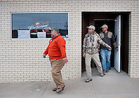 From left, PR and Web Director for the National Wild Turkey Federation Brent Lawrence (cq), OutdoorLife Editor Andrew McKean (cq) and Web Editor for Ducks Unlimited Chris Jennings (cq) exit Dave's Place after lunch during a hunting trip in Superior, Nebraska, Thursday, December 1, 2011...Photo by Matt Nager