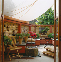 Roof terrace with wood framed screen and sail cloth awning