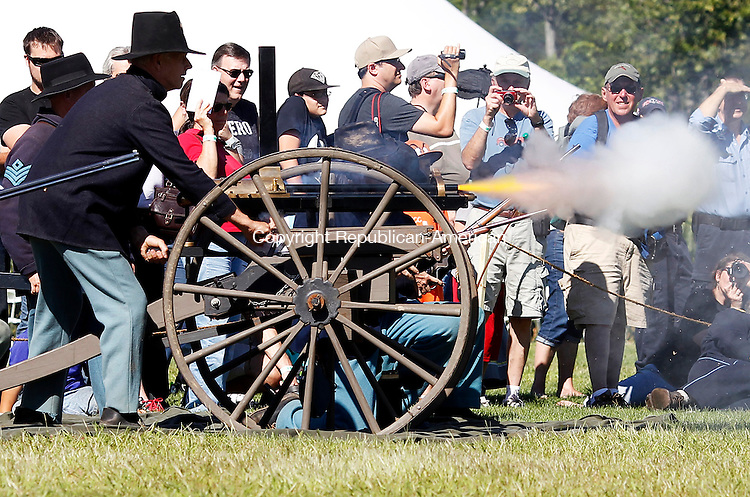 Woodbury, CT- 24 August 2013-082413CM05-  Union soldiers give a demonstration of a Gatling Gun during a civil war reenactment at the Strong Preserve Park in Woodbury Saturday afternoon.  The history continues Sunday with camps opening to the public at 8:30a.m.  The reenactment of the Battle of Snodgrass Hill, Chickamauga, September 1863, will be held at 1:30p.m.  The camp will break at 3p.m.      Christopher Massa Republican-American