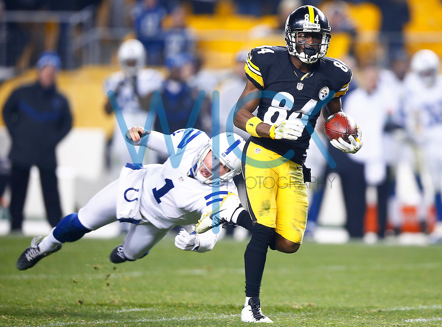Antonio Brown #84 of the Pittsburgh Steelers runs back a punt for a touchdown in the fourth quarter past Pat McAfee #1 of the Indianapolis Colts during the game at Heinz Field on December 6, 2015 in Pittsburgh, Pennsylvania. (Photo by Jared Wickerham/DKPittsburghSports)