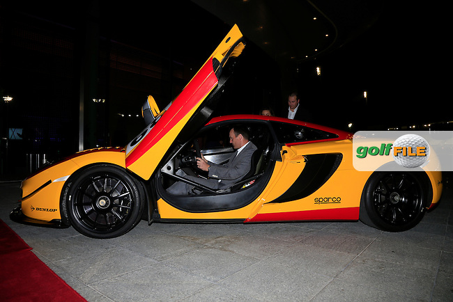 Michael Hoey gets behind the wheel of the Dragon Racing car on display at the Gala Dinner at the Abu Dhabi Invitational 2015, Yas Links golf club, Abu Dhabi, UAE.<br />