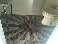 Custom Starburst shown in Aluminum, Thassos, Calacatta Tia, Bardiglio, and Nero Marquina polished.