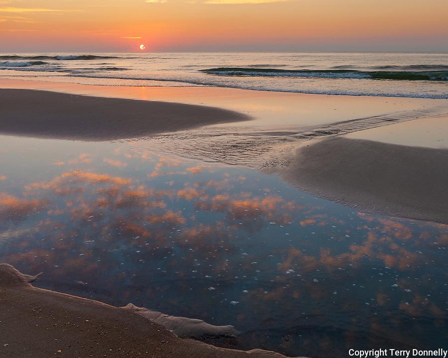 Ocracoke Island, North Carolina: Sunrise clouds reflected in a tide current on a quiet beach - Cape Hatteras National Seashore