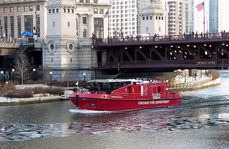 "Chicago Scenes: Chicago Engine 2 fire boat ""Christopher Wheatley"" motoring through down the Chicago River, just east of Michigan Ave.  (DePaul University/Jamie Moncrief)"