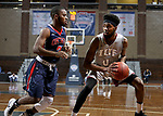 SIOUX FALLS, SD - MARCH 9:  Kendall Rollins #0 from IU East looks to make a move against Elbert Lawrence #3 from Oklahoma Wesleyan in their second round game at the 2018 NAIA DII Men's Basketball Championship at the Sanford Pentagon in Sioux Falls. (Photo by Dave Eggen/Inertia)