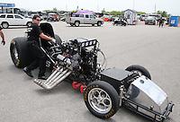 Apr. 26, 2013; Baytown, TX, USA: NHRA crew members for funny car driver Cruz Pedregon during qualifying for the Spring Nationals at Royal Purple Raceway. Mandatory Credit: Mark J. Rebilas-