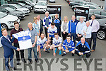 New Deal<br /> --------------<br /> Denis Divane of Divane Volkswagen, Castleisland, (far Lt) presents the Chairman of Castleisland Desmonds GAA club, Jimmy O'Connell with their new jersey and sponsor logo, with Kerry manager, Eamonn Fitzmaurice, Divanes Volkswagen ambassador also present as well as club&amp;team members last Friday evening in the town.