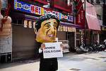 JUNE 28, 2019 - A protestor wears a mask of Japanese Prime Minister Shinzo Abe at a protest against coal power during the G20 Summit in Osaka, Japan. (Photo by Ben Weller/AFLO) (JAPAN) [UHU]