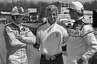LEXINGTON, OH - 1982: Bobby Rahal (left) and team owner Jim Trueman (center) speak with author George Plimpton during a private test session when Plimpton drove the team's March 82C/Cosworth in late 1982 at the Mid-Ohio Sports Car Course near Lexington, Ohio.