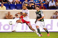 Thierry Henry (14) of the New York Red Bulls is marked by Sal Zizzo (7) of the Portland Timbers. The New York Red Bulls  defeated the Portland Timbers 3-2 during a Major League Soccer (MLS) match at Red Bull Arena in Harrison, NJ, on August 19, 2012.