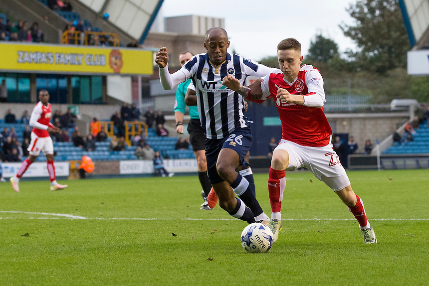Fleetwood Town's Ashley Hunter battles for possession with Millwall's Nadjim Abdou<br /> <br /> Photographer Craig Mercer/CameraSport<br /> <br /> The EFL Sky Bet League One - Millwall v Fleetwood Town - Saturday 22nd October 2016 - The Den - London<br /> <br /> World Copyright &copy; 2016 CameraSport. All rights reserved. 43 Linden Ave. Countesthorpe. Leicester. England. LE8 5PG - Tel: +44 (0) 116 277 4147 - admin@camerasport.com - www.camerasport.com