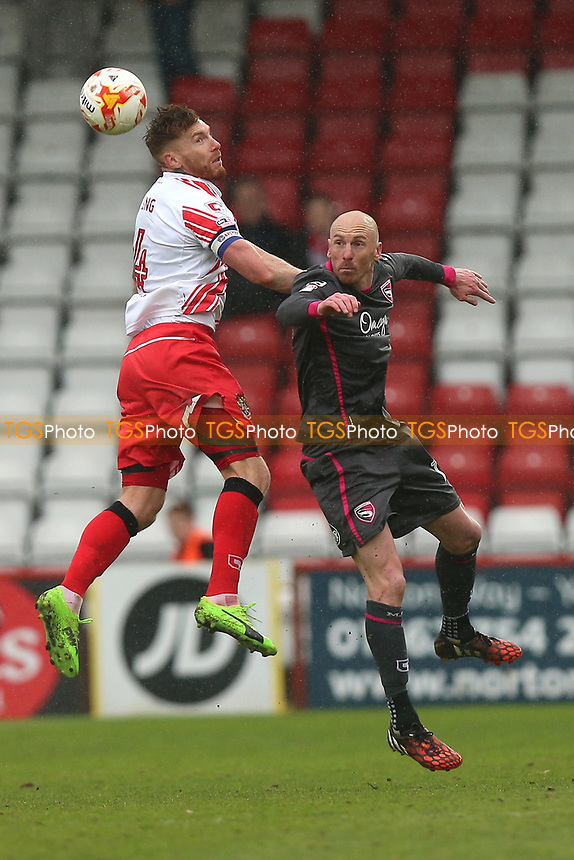 Jack King of Stevenage rises with Kevin Ellison of Morecambe during Stevenage vs Morecambe, Sky Bet EFL League 2 Football at the Lamex Stadium on 14th April 2017