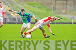 East Kerry's Andrew Garnett and Dingle's  Aodán O'Neill.