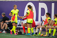 Orlando, Florida - Sunday, May 8, 2016: Seattle Reign FC forward Merritt Mathias (9) is greeted by Seattle Reign FC defender Paige Nielsen (12) after substituting out of the game during a National Women's Soccer League match between Orlando Pride and Seattle Reign FC at Camping World Stadium.
