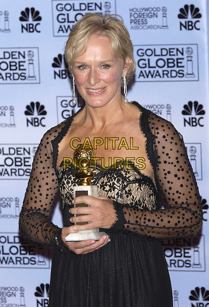 GLENN CLOSE .At the 62nd Annual Golden Globe Awards, Beverly Hilton Hotel, Los Angeles, USA, January 16th 2005.                 .half length trophy award black lace dress long sleeved .Ref: PL.www.capitalpictures.com.sales@capitalpictures.com.©Capital Pictures.
