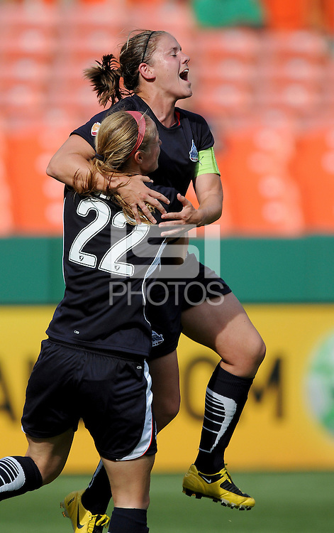 Washington Freedom  defender Cat  Whitehill  (4) celebrates her goal with teammate Becky Sauerbrunn.  Washington Freedom defeated Sky Blue FC 2-1 at RFK Stadium, Saturday May 23, 2009.