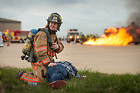 NWA Democrat-Gazette/BEN GOFF @NWABENGOFF<br /> Dan Collins, Highfill volunteer firefighter, tends to 'victim' Jimmie Meadows of Bella Vista Friday, March, 23, 2018, during disaster training at Northwest Arkansas Regional Airport in Highfill. Multiple Northwest Arkansas emergency agencies participated in the training, with volunteers acting as victims to create a simulated aircraft emergency. The airport holds the large-scale, multi-agency drills every three years according to Gilbert Neil, the airport's public safety director.