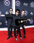 LOS ANGELES, CALIFORNIA, USA - NOVEMBER 24: Mike Dirnt, Billie Joe Armstrong and Tre Cool of Green Day arrive at the 2019 American Music Awards held at Microsoft Theatre L.A. Live on November 24, 2019 in Los Angeles, California, United States. (Photo by Xavier Collin/Image Press Agency)