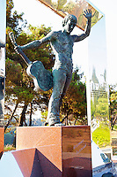 A modern statue of a musician with a guitar, framed by a silver square. Near the Millennium Bridge. UNK Podgorica capital. Montenegro, Balkan, Europe.