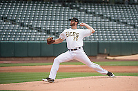 Scott Snodgress (36) of the Salt Lake Bees delivers a pitch to the plate against the Tacoma Rainiers in Pacific Coast League action at Smith's Ballpark on May 7, 2015 in Salt Lake City, Utah. The Bees defeated the Rainiers 11-4 in the completion of the game that was suspended due to weather on May 6, 2015.(Stephen Smith/Four Seam Images)