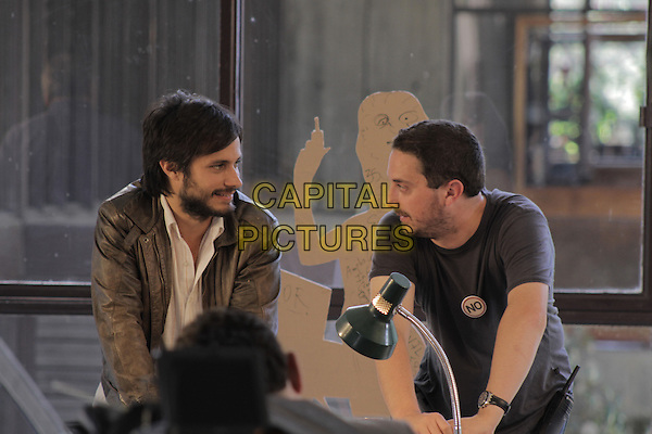 Gael Garcia Bernal & director Pablo Larrain.on the set of No (2012).*Filmstill - Editorial Use Only*.CAP/FB.Supplied by Capital Pictures.