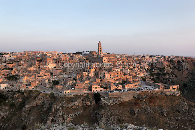 Sassi di Matera, the old part of town built on original prehistoric troglodyte dwellings, at Matera, Basilicata, Southern Italy. The Sassi are thought to be the oldest human settlement in Italy, dating back to 7000 BC. The 52m bell tower of Matera Cathedral, built 1268ñ70, dominates the skyline. Matera is known as la Citta Sotterranea or the Subterranean City, and is listed as a UNESCO World Heritage Site. Picture by Manuel Cohen