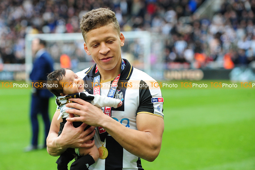 Dwight Gayle of Newcastle United holds his daughter after the final whistle during Newcastle United vs Barnsley, Sky Bet EFL Championship Football at St. James' Park on 7th May 2017