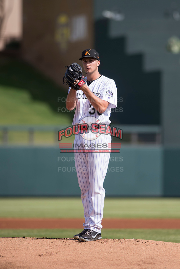 Salt River Rafters starting pitcher Ryan Castellani (38), of the Colorado Rockies organization, gets ready to deliver a pitch during an Arizona Fall League game against the Glendale Desert Dogs at Salt River Fields at Talking Stick on October 31, 2018 in Scottsdale, Arizona. Glendale defeated Salt River 12-6 in extra innings. (Zachary Lucy/Four Seam Images)