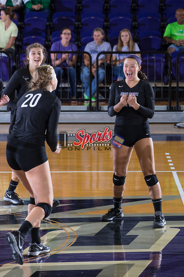 Wavie Chin (13) of the High Point Panthers celebrates after her team scored a point against the Marshall Thundering Herd at the Panther Invitational at the Millis Athletic Center on September 12, 2015 in High Point, North Carolina.  The Thundering Herd defeated the Panthers 3-2.   (Brian Westerholt/Sports On Film)