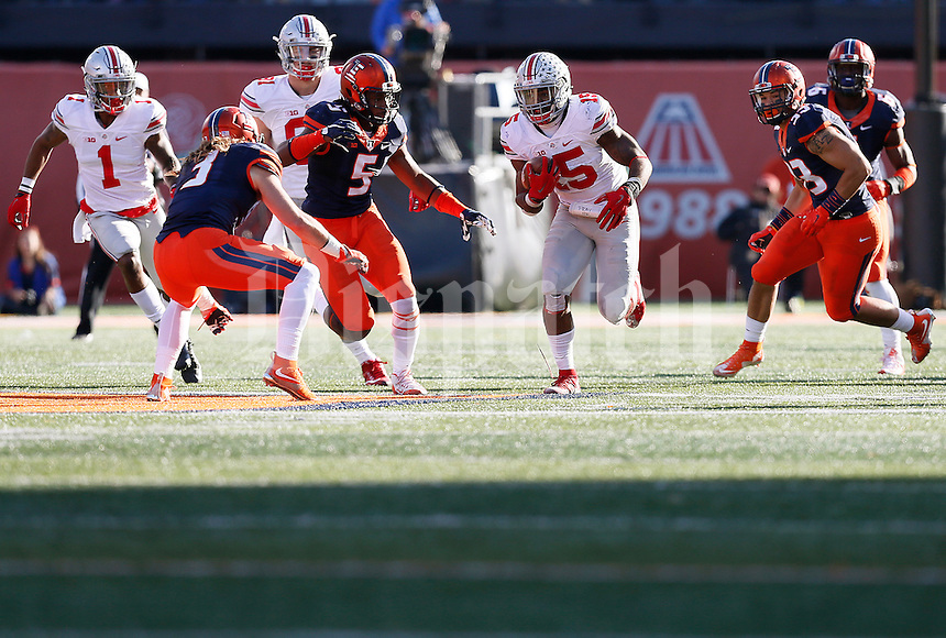 Ohio State Buckeyes running back Ezekiel Elliott (15) runs the ball in the fourth quarter of the college football game between the Ohio State Buckeyes and the Illinois Fighting Illini at Memorial Stadium in Champaign, Ill., Saturday morning, November 14, 2015. The Ohio State Buckeyes defeated the Illinois Fighting Illini 28 - 3. (The Columbus Dispatch / Eamon Queeney)