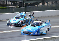 Jun 6, 2016; Epping , NH, USA; NHRA funny car driver Tommy Johnson Jr (near) races alongside Jeff Diehl during the New England Nationals at New England Dragway. Mandatory Credit: Mark J. Rebilas-USA TODAY Sports