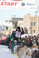 Matt Hall and team leave the ceremonial start line with an Iditarider at 4th Avenue and D street in downtown Anchorage, Alaska on Saturday March 2nd during the 2019 Iditarod race. Photo by Brendan Smith/SchultzPhoto.com