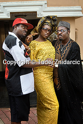 Film actors Emeka Ike and Funsho Adeolu (left and right), playing businessmen and friends and actress Ufuoma Ejenobor (center), playing wife of Adeolu, on the set of a Nollywood movie production.