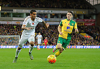 Kyle Naughton of Swansea City and Robbie Brady of Norwich City during the Barclays Premier League match between Norwich City and Swansea City played at Carrow Road, Norwich on November 7th 2015