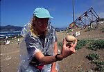 Rhinoceros auklet researcher with egg