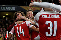 Arsenal players congratulate Pierre-Emerick Aubameyang after scoring their third goal during Arsenal vs Rennes, UEFA Europa League Football at the Emirates Stadium on 14th March 2019