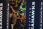 Seattle Seahawks  running back Marshawn Lynch points skywards during introductions before kickoff against the Carolina Panthers in the NFC Western Division Playoffs at CenturyLink Field  on January 10, 2015 in Seattle, Washington. The Seahawks beat the Panthers 31-17. ©2015. Jim Bryant Photo. All Rights Reserved.