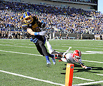 BROOKINGS, SD - OCTOBER 22:  Connor Landberg #18 from South Dakota State University slips past the defense of Kenny Bishop #7 from Youngstown State in the first half of their game Saturday afternoon at Dana J. Dykhouse Stadium in Brookings. (Photo by Dave Eggen/Inertia)