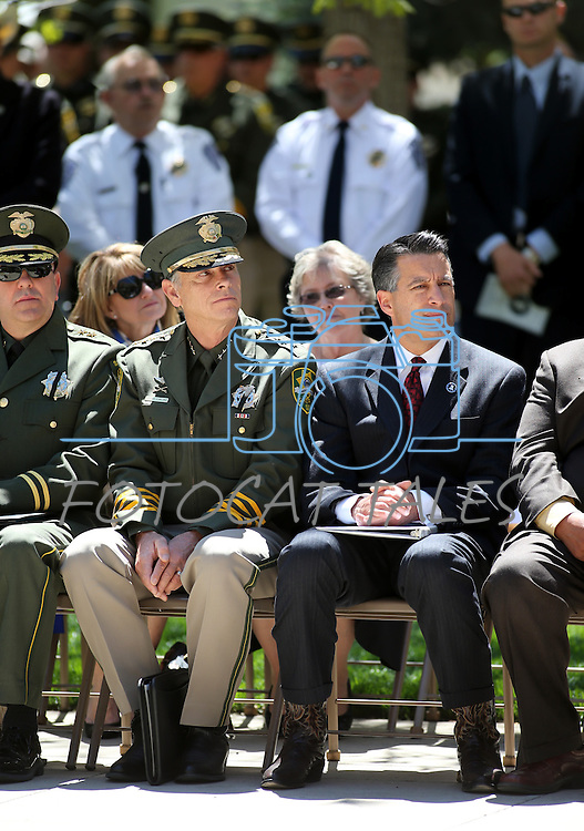Carson City Sheriff Ken Furlong and Gov. Brian Sandoval listen to the Nevada Law Enforcement Officers Memorial ceremony on Thursday, May 2, 2013, at the Capitol in Carson City, Nev..Photo by Cathleen Allison