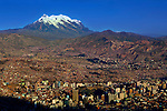 Snow covered Mt Illimani overlooks the city of La Paz.  The mirador Templo Andino Jach'a Apacheta is the highest point in the city of El Alto and provides spectacular views of La Paz and the surrounding mountains.