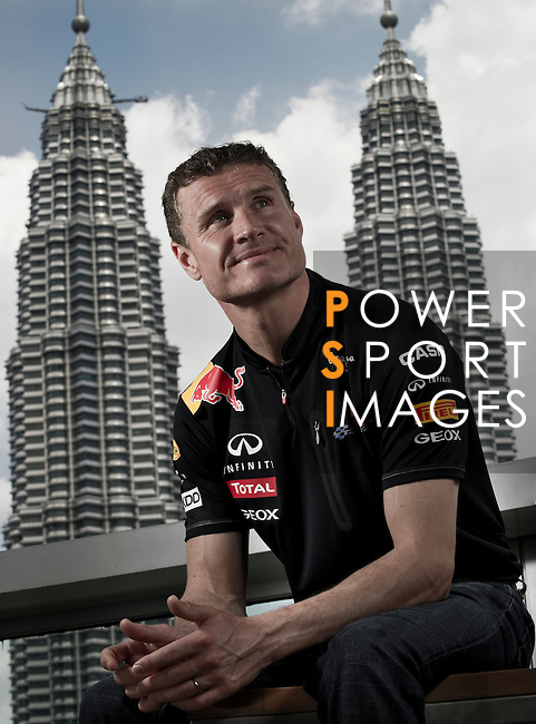 David Coulthard poses in front of the Petronas Twin Towers prior the Red Bull Speed Street Kuala Lumpur, at the main shopping street Jalan Buit Bintang in Kuala Lumpur, Malaysia on 3rd April 2011.