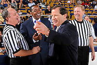25 February 2012:  FIU Head Coach Isiah Thomas, South Alabama Head Coach Ronnie Arrow, and officials enjoy a light moment prior to the game.  The FIU Golden Panthers defeated the University of South Alabama Jaguars, 81-74, at the U.S. Century Bank Arena in Miami, Florida.
