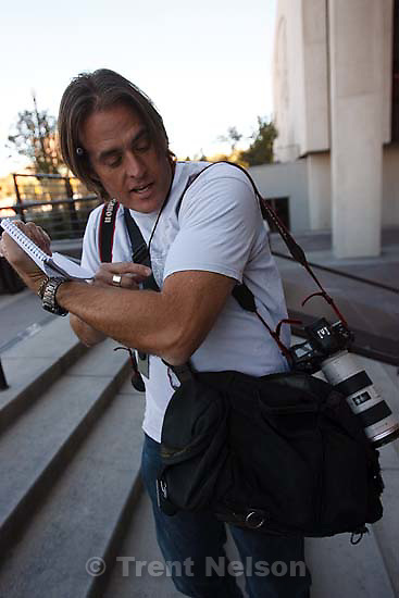 Keith Johnson with his camera bag.
