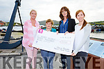 Paula Brennan left and Aideen O'Sullivan right presenting a cheque for €3K to Mairead Lynch and Trish O'Sullivan from Iveragh Group Kerry Hospice Foundation.  The money was raised from the Skellig Rangers Breast Cancer Ladies Football Tournament.