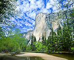 """El Capitan,  granite monolith 3,000 ft (910 m) from base to summit along tallest face, one of the world's favorite challenges for rock climbers..Named """"El Capitan"""" by the Mariposa Battalion when it explored the valley in 1851. El Capitán (""""the captain"""", """"the chief"""") was taken to be a loose Spanish translation of the local Native American name for the cliff, variously transcribed as """"To-to-kon oo-lah"""" or """"To-tock-ah-noo-lah"""". Composed almost entirely of El Capitan Granite, a pale, coarse-grained granite roughly 100 million years old. Yosemite National Park (est. 1906), 761,268 acres (3,080.74 km2), 1,189 sq mi (3,080 km2). Park elevations range from 2,127 to 13,114 feet (648 to 3,997 m) and contains five major vegetation zones: chaparral/oak woodland, lower montane, upper montane, subalpine, and alpine. Yosemite Valley carved by glacial movement about 1 million years ago. World Heritage Site (1984). Mariposa County, CA."""